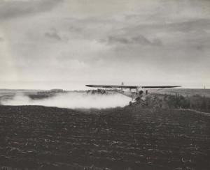 Crop dusting by airplane, Honolulu, 1930s.