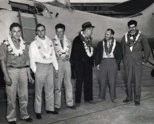 Crew of the Guba flying laboratory plane. Plane is owned by Richard Archibold, right, Standard Oil heir, and was flown from San Diego to Honolulu in 18 hrs 8 min, a new record.