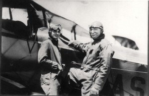Governor W. R. Farrington stands next to unidentified aviator.