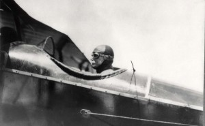 Governor W. R. Farrington in cockpit of plane.