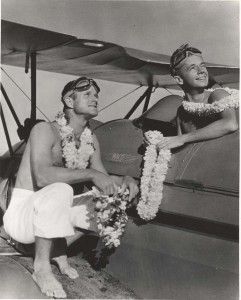 William Cross Jr. and Walter Dillingham Jr. dropped flower lei to passengers arriving on liners in Hawaii, April 1935.