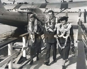 Leaving giant Pan American China Clipper plane after 2,400 miles over water flight are Elizabeth Whittingham of New Jersey and Mr. and Mrs. Thomas Wilson of Seattle. He is Vice President of the Alaska Steamship Co.