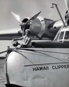 Patricia Kennedy christens the Pan American Hawaii Clipper with coconut water, at Pearl Harbor. May 1936