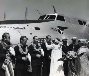 Helen Poindexter presents lei to the crew of the Pan American Honolulu Clipper at christening ceremony. 1939