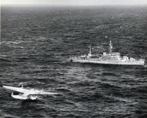 The seaplane tender USS San Pedro attempts to hook a towline to the stricken Pan American Honolulu Clipper which was downed at sea 700 miles NE of Honolulu.