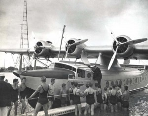 Pan American pilot Edwin C. Musick climbs down from his Clipper ship.