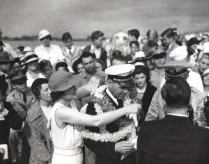 Capt. Edwin C. Musick, skipper of the Pan American Clipper receives a lei upon arrival in Honolulu April 20, 1935. His plane carried the first air mail to arrive in Hawaii.