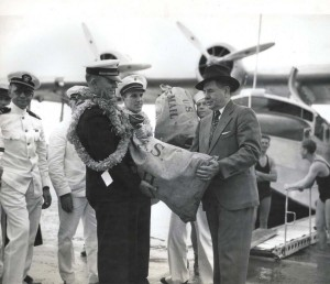 First official consignment of federal mail when R. O. H. Sullivan, executive officer of the Pan American Clipper turned over the government bags to John H. Wilson, U.S. Postmaster at Honolulu 18 hours after the mail was dispatched in California.