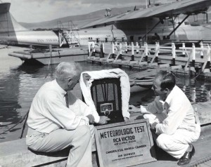 RCA Victor radio set arrives at Honolulu on Pan American Clipper. W H Stone, Mutual Telephone Co. & RCA distributor, and J A Brooks, PAA employee unload the set.