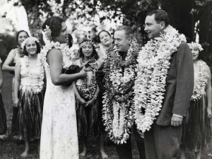 Roy Howard, publisher of the New York World Telegram, and Juan Trippe, president of Pam American Airways, are serenaded upon their arrival at Honolulu on the Pan American Philippine Clipper, October 1936.