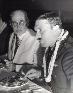 Roscoe Turner, American Flyer, and Judge Walter F. Frear, former Governor of the Territory, at a dinner honoring Clyde Pangborn and Turner who arrived in Hawaii on November 26, 1934 after finishing second in the London to Melbourne Air Derby. Their Boeing plane was carried on a ship to Hawaii.