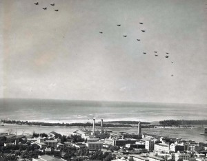 U.S. Army Air Corps December 21, 1934. U.S. service planes in formation over Honolulu honoring the Wright Brothers. The planes later flew out to sea and dropped leis in memory of Capt Charles Ulm and his companions who died attemping to fly beween California and Australia.
