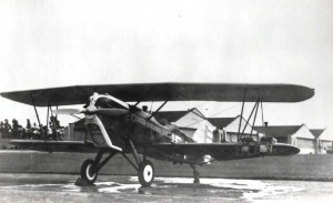 A-3 at Wheeler Field with hangars in background.