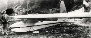 """International Glider Meet Dec. 17-18, 1931. Lt. William A. Cocke of Wheeler's 19th Pursuit Squadron stands alongside his """"Nighthawk"""" glider in which he broke the official world record of 14 hours & 7 minutes. Note unofficial 19th Pursuit Squadron insignia on tail of glider."""