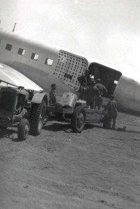 Unloading rations and supplies from C-33 (DC-3) from Hickam at Morse Field, Hawaii, 1940.