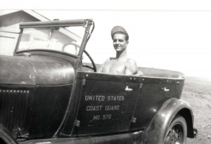 Pvt. Stanley Koenig of Morse Field sits in a 1929 Model A Ford which was used by Mr. Gibson, the lighthouse keeper at South Point, Hawaii, 1941.