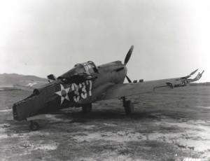 Three P-40s that attempted to take off from Bellows Field on December 7, 1941 were shot down immediately. Most of the 12 P-40s there, like this one, lined up in neat rows, were riddled by Japanese machine gun fire.