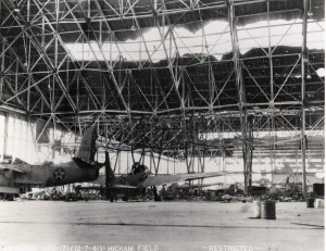 Hangar 35 Dock 1 at Hickam Field with an A-20A aircraft of the 5th Bomb Group on left and O-49 aircraft on right, December 7, 1941.