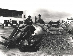A hastily constructed gun emplacement in front of Hangar 5 was manned by PFC Raymond Perry and Cpl Howard Marquardt shortly after Japanese raid on Hickam Field, December 7, 1941.