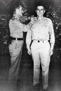 Maj. Gen. Clarence A. Tinker, commanding general of 7th Air Force, pins stars of Brig. Gen. on Col. William Farthing, Commander of the 7th Air Force Base Command, at Hickam Field, October 1, 1941.