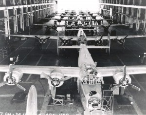 B-24J Liberators inside a maintenance hangar at Hickam Field, Hawaiian Air Depot, July 30, 1944.