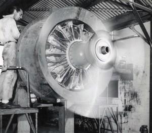 Hawaiian Airlines. Mechanic works on plane engine.