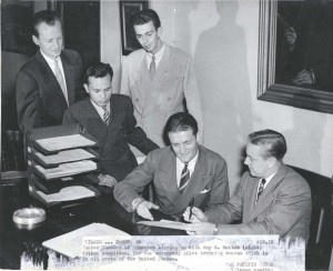 Members of Honolulu Jr. Chamber of Commerce sign up a volunteer for an emergency pilot training course, 1940s.
