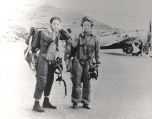 Pilots of 333rd Fighter Squadron, Bellows Field, in early 1944. Lts. Mormon and Bower prepare for familiarization flight in newly arrived P-47s.