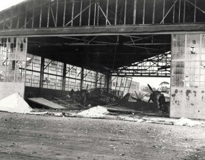 Wrecked hangar with destroyed planes at Wheeler Field, December 7, 1941.