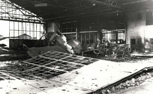 Severely damaged P-36 sits in wrecked hangar at Wheeler Field, December 7, 1941.