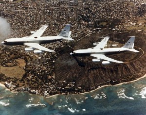 EC-135J Stratotankers (63-8056 and 63-8057) assigned to 9th Airborne Command & Control Squadron, Hickam Air Force Base, in mid air refueling operation near Diamond Head, c1957-1958.