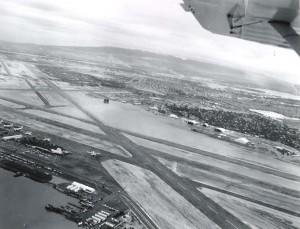 Honolulu International Airport showing the end of Runway 26 looking toward Pearl Harbor, March 6, 1958.