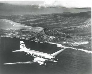 Hawaiian Airlines flight over Diamond Head, 1950s.