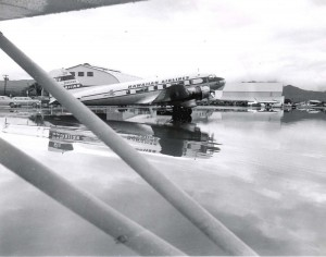 Hawaiian Airlines plane ramp looking towards Hangars 3 and 4 at Honolulu International Airport, March 6, 1958.