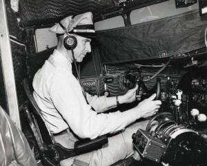 Hawaiian Airlines pilot at controls, Honolulu International Airport, 1950s.