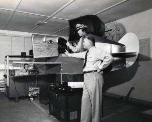 Hawaiian Airlines pilot R. S. Barnes trains in a simulator at Honolulu International Airport, c1953.