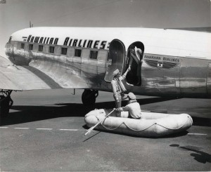 Hawaiian Airlines life saving raft is shown at Honolulu International Airport, 1950s.