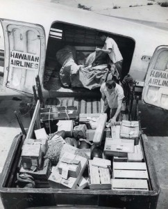 Hawaiian Airlines cargo is loaded aboard a plane at Honolulu International Airport, 1950s.