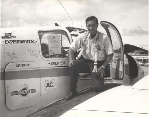 Capt. Charles Banfe on the wing of his experimental aircraft at Honolulu International Airport, 1950s.