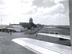 Passengers disembark from an Pan American plane at Honolulu International Airport, 1950s.