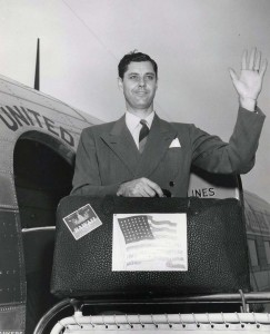 George McLean, executive secretary of the Hawaii Statehood Commission, is ready to board United Airlines plane at Honolulu International Airport for Washington, D.C., 1950s.