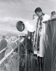 The Reverend Abraham Akaka conducts the blessing during the groundbreaking ceremony for Kahului Airport, February 3, 1959.