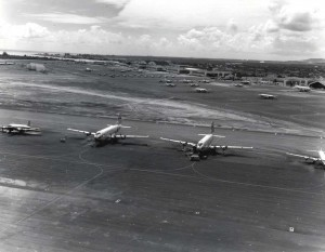 Flight line at Hickam Air Force Base, Hawaii, with C-124 aircraft in foreground, 1964.