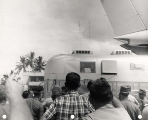 F-102 aircraft of the Hawaii Air National Guard salute the men of Apollo 11 while their mobile quarantine facility was being loaded aboard a C-141 at Hickam Air Force Base, 1969.
