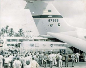 The Mobile Quarantine facility containing the men of Apollo 11 is loaded aboard a C-141 at Hickam Air Force Base, Hawaii, 1969.