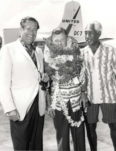 On July 12, 1964 the roadway in front of the Lei Stands at Honolulu International Airport was dedicated to legendary entertainer Arthur Godfrey. The ukulele-strumming Godfrey had been visiting the islands and promoting them on his nationally-televised radio and television shows for more than 20 years. He was a life-time aviation buff and held a commercial airline pilot certificate. He was a pilot/ambassador for Eastern Airlines and even took pilot certification lessons from Hawaiian Airlines. He's shown here with Lee Holtzman, general manager of the Royal Hawaiian Hotel, and the legendary Duke Kahanamoku.