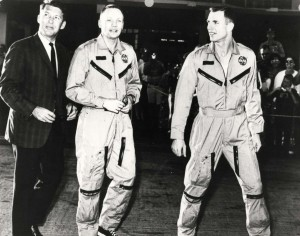 Gemini 8 Astronauts Neil Armstrong and David Scott arrive at Hickam Air Force Base Hawaii from Okinawa following successful completion of their flight. They were accompanied by astronaut Walter Schirra (left) and NASA officials, 1966