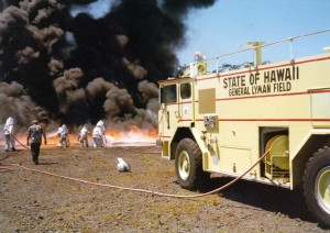 Aircraft Rescue and Fire Fighting hot fire drill, General Lyman Field, Hilo, Hawaii, 1983.