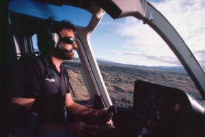 Helicopter flying over lava fields, Kona, 1985.