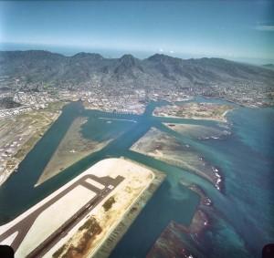 Reef Runway in foreground, with Keehi Lagoon and Honolulu in background, Honolulu International Airport, January 1, 1982.